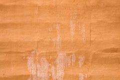 橙色被弄脏的墙壁 库存图片
