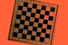 橙色被掀动的棋盘设计 皇族释放例证