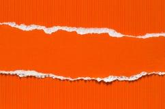 橙色被撕毁的纸背景纹理 库存照片