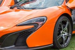 橙色跑车左前面 免版税库存图片
