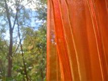 橙色透明硬沙帷幕关闭 免版税库存图片
