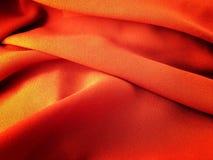 橙色金织品背景纹理 免版税库存图片