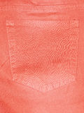 橙色长裤的后面口袋 免版税库存照片