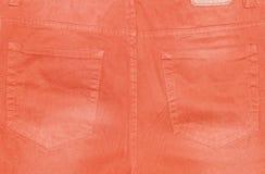 橙色长裤的后面口袋 免版税库存图片