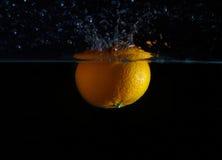 橙色飞溅水 库存照片