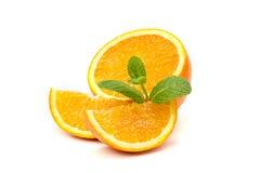 橙色,橙色切片和薄荷叶 库存照片