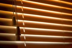 橙色水平的窗帘 库存照片
