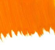 橙色水彩背景。 库存照片