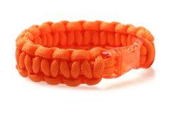 橙色巴拉绳子镯子 免版税库存照片