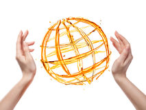 从橙色水的地球用在白色隔绝的人的手 库存图片