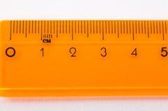 橙色统治者特写镜头 免版税库存图片