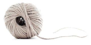 橙色结辨的丝球,钩针编织在白色背景隔绝的螺纹球 免版税图库摄影