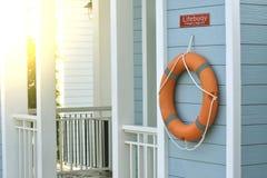 橙色lifebuoy,所有水抢救事故设备 免版税库存图片