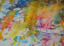橙黄色蓝色察觉背景,闪耀的泥泞的蜡状的油漆,对比在淡色颜色的形状背景 图库摄影