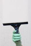 橡皮刮板洗衣机视窗 免版税库存照片