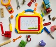 橡胶五颜六色,明亮,各种各样的与的玩具和塑料魔术家 免版税图库摄影