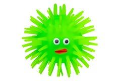 橡胶玩具 滑稽的绿色河豚做了橡胶 在白色背景隔绝的逗人喜爱的玩具鱼 宏指令 库存照片