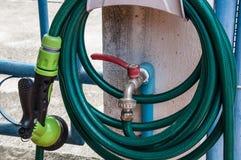 橡胶软管和喷嘴卷轴  免版税库存图片