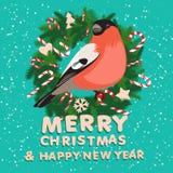 欢乐圣诞节花圈用糖果、红腹灰雀和木信件 库存图片