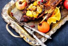 欢乐烤鸭用桔子和蔓越桔 库存照片