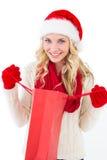 欢乐白肤金发的举行的购物袋 库存图片