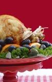 欢乐红色题材感恩圣诞节土耳其盛肉盘 免版税库存图片