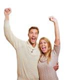 欢呼与握紧拳头的夫妇 免版税图库摄影