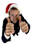 欢呼圣诞老人的生意人盖帽 免版税库存照片