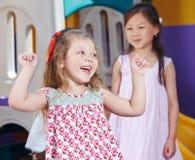 欢呼的女孩在幼儿园 免版税图库摄影