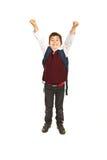 欢呼的男小学生 免版税库存图片