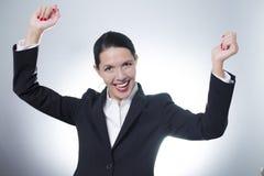 欢腾女实业家欢呼 免版税图库摄影