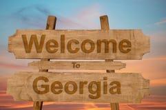 欢迎光临乔治亚在木背景唱歌 免版税库存图片
