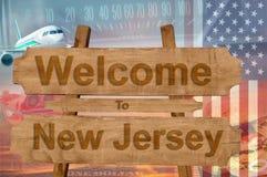 欢迎到新泽西状态在美国在木头, travell题材签字 免版税库存照片
