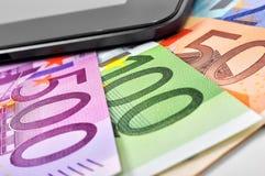 欧元和手机 库存图片