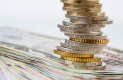 欧元和美元钞票和欧洲硬币 库存照片