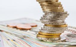欧元和美元钞票和欧洲硬币 图库摄影