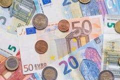 欧洲钞票和硬币关闭作为背景 免版税图库摄影