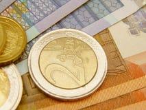 欧洲钞票的硬币 库存图片