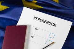 欧盟公民投票选票、黑笔和护照在桌上 库存照片