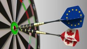 欧盟和加拿大的旗子击中目标的舷窗的箭的 国际合作或竞争 股票视频
