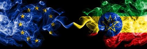 欧盟对埃塞俄比亚,肩并肩被安置的埃赛俄比亚的烟旗子 欧盟和埃塞俄比亚的厚实的色的柔滑的 皇族释放例证