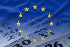 欧盟旗子与日历的在背景中 库存照片