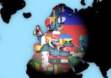 欧洲与旗子的世界地图 库存照片