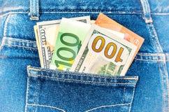 欧洲和美国货币,在牛仔裤的金钱为旅行装在口袋里 库存图片