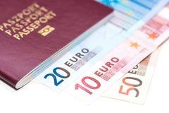 欧洲护照和欧元在白色 免版税图库摄影