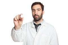 年轻欧洲医生机智药片画象  免版税库存图片