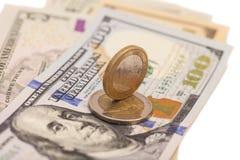 欧洲硬币和美元 免版税库存照片