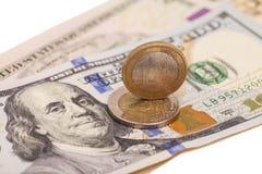 欧洲硬币和美元 库存图片