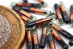 欧洲硬币和id植入管 库存照片