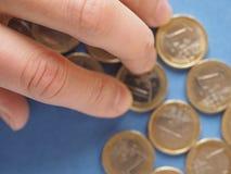 欧洲硬币,在蓝色的欧盟 库存图片